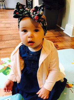 baby india in soft floral headwrap
